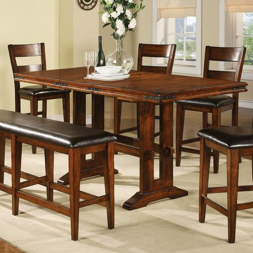 """Features:  -Material: Mango veneer and solid hardwood.  -Decorative metal corner brackets.  -Removable 18"""" leaf.  -Lightly distressed finish.  Distressed: -Yes.  Top Material: -Manufactured wood.  Bas"""