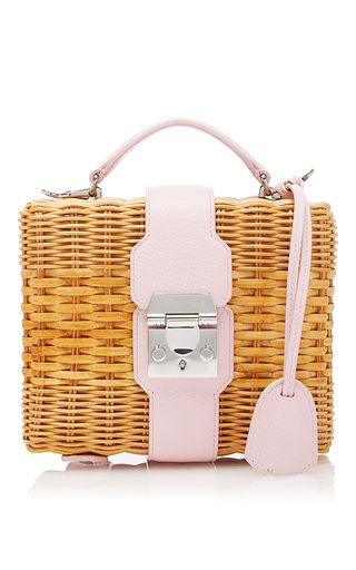 This bag by **Mark Cross** is rendered in pebble grain leather and rattan and…
