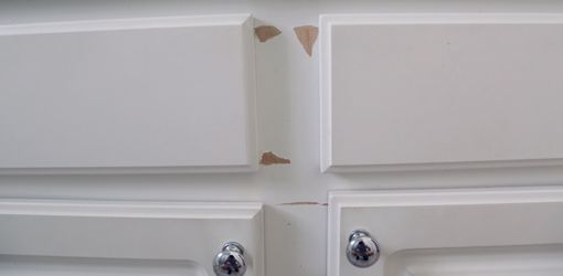 Find out how to reattach the plastic melamine coating on bathroom and kitchen cabinets, and how to sand and paint over plastic coated cabinets.