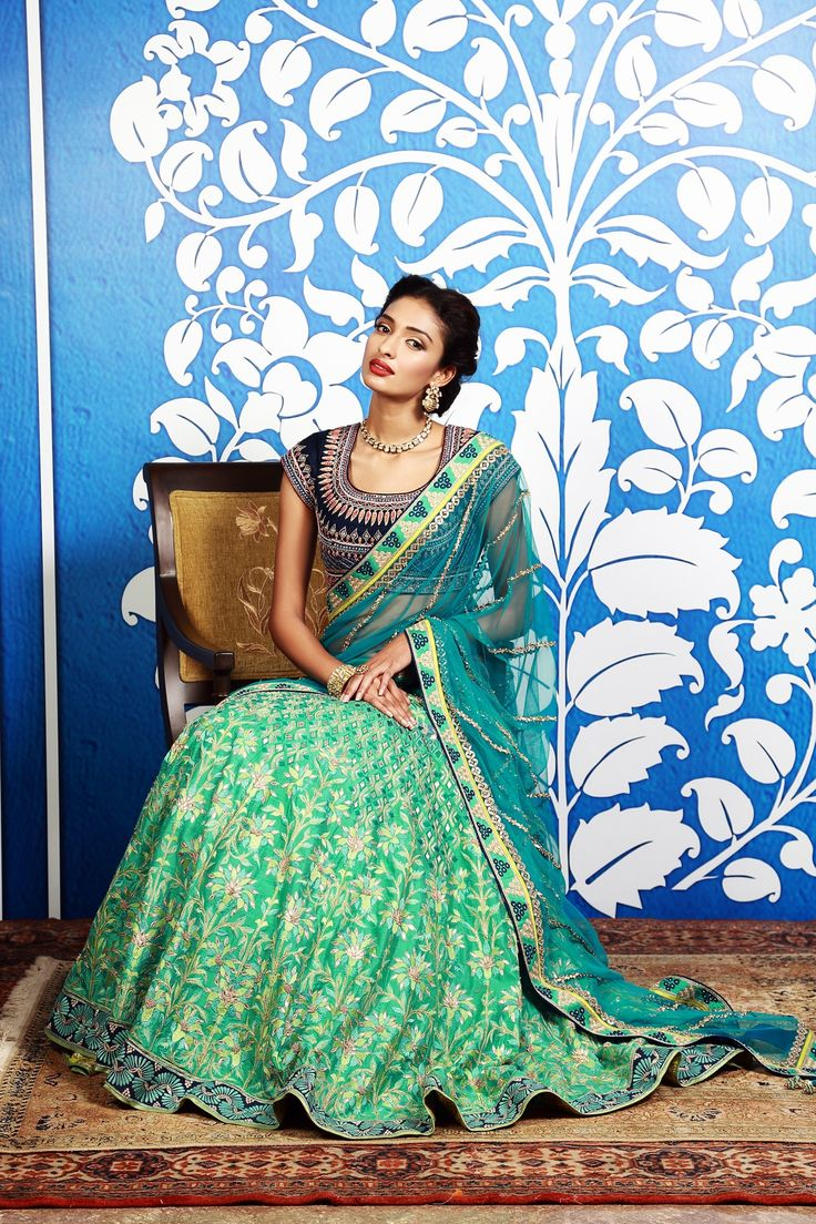 A timeless yet unique combination of sea green and blue with traditional Banaras Brocade lehenga. Indian fashion.