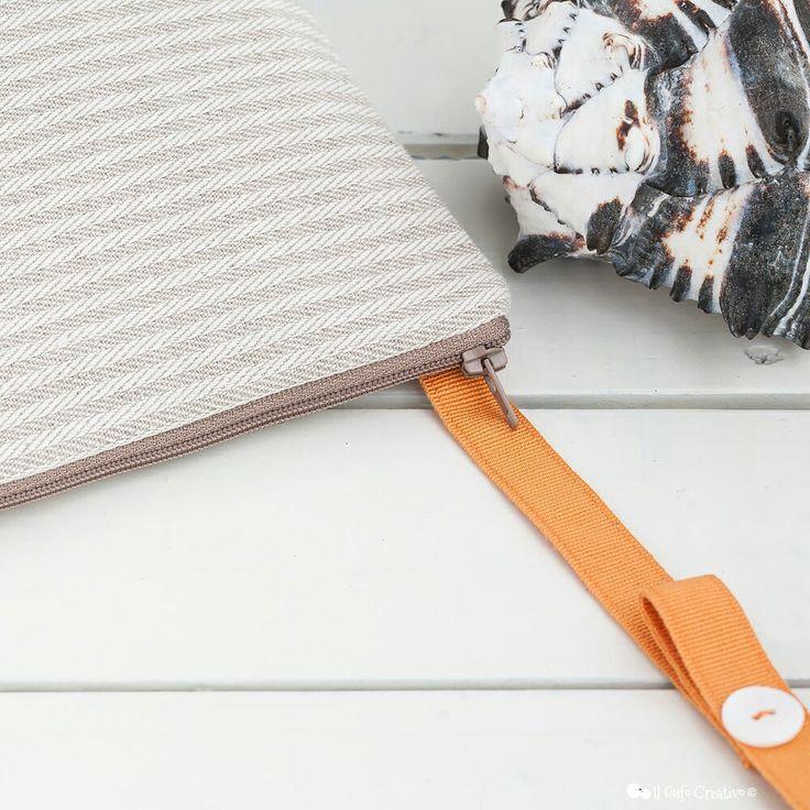 A fabric crossbody bag in neutrale tones