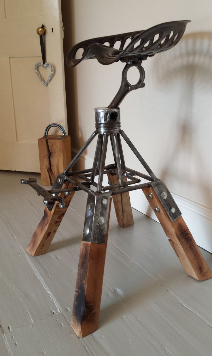 Bar stool made from engine piston and tractor seat.