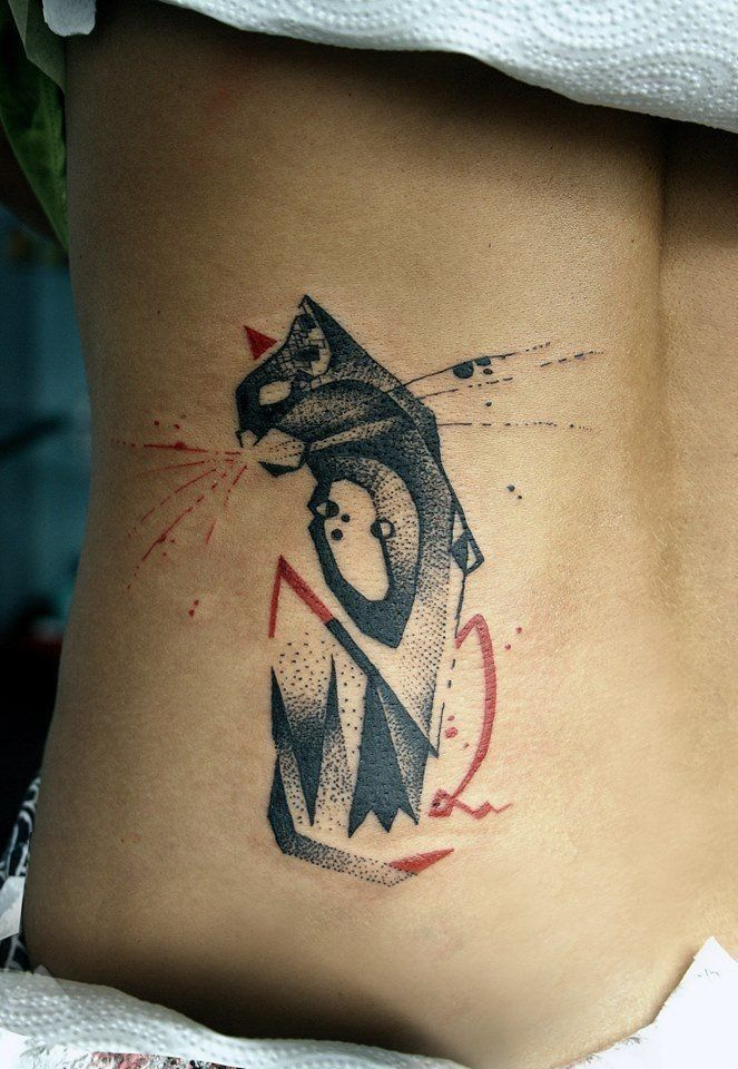 Lovely black red geometric cat tattoo on ribs