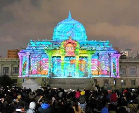 Thousands of spectators enjoy the colorful illumination projected on to the main hall of the Tsukiji Hongwanji temple in Tokyo's Tsukiji district.