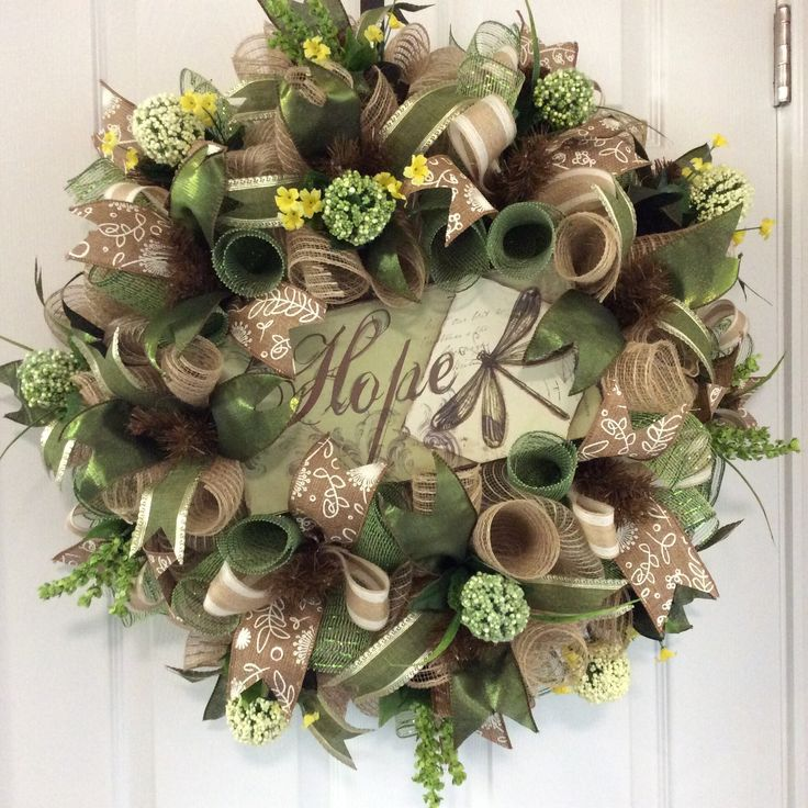 """""""Hope Wreath"""" ($106) This is what we long for and dream about everyday! It is 24""""x24""""x8""""deep, on a chocolate wire frame, burlap deco mesh, burlap/olive green deco mesh curls, hope wood sign embellishment, 2.5"""" tan/white floral print burlap ribbon, 2.5"""" olive green shimmer ribbon, 1.5"""" olive green/gold trim ribbon, 1.5"""" natural/tan burlap ribbon formed into a bow, white/green pom-pom flowers, yellow flowers, and green foliage! If interested, please message me. Thank you!"""