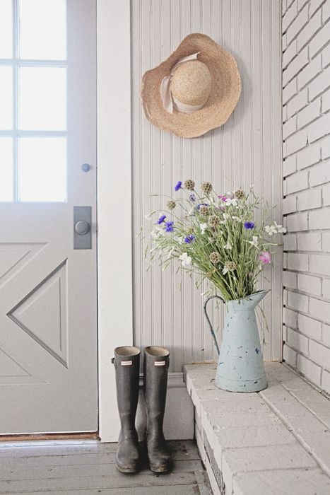 The perfect farmhouse entry. I love the door; it's just like the Rochester design we sell.