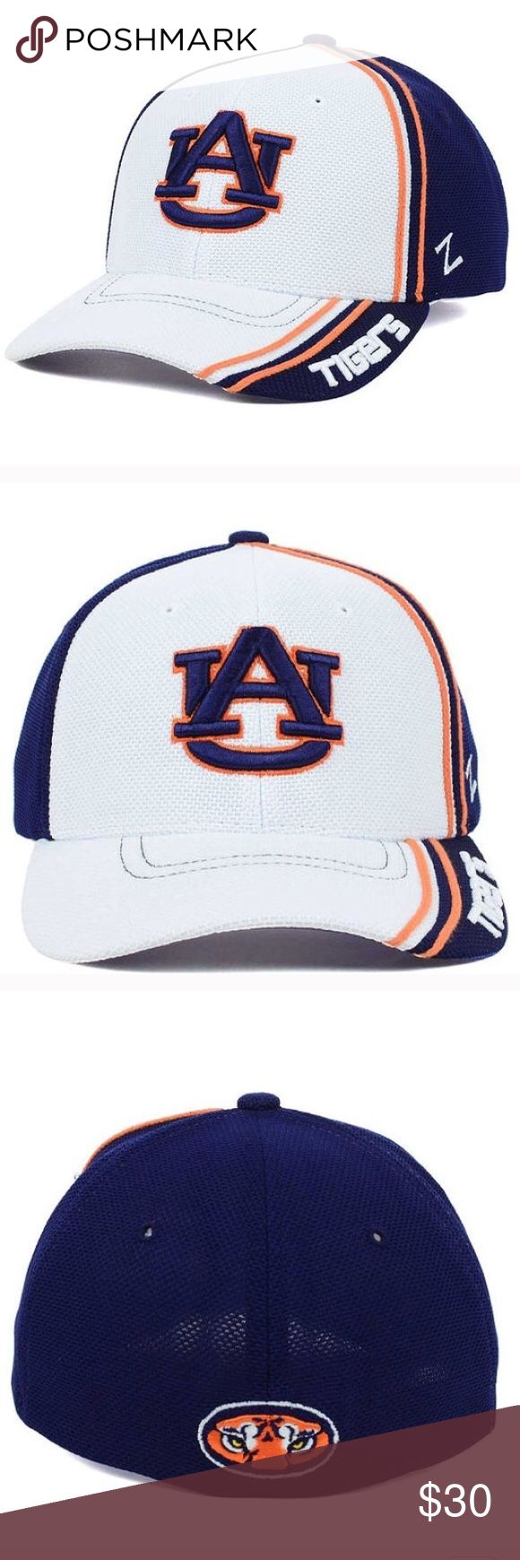 Auburn tigers hat Show your support for the NCAA and the Auburn Tigers this year with the Auburn Tigers NCAA Slash AG Cap. Rain or shine, this White hat will keep you in style all year long. Stay comfortable and cool with this structured hat, featuring a normal bill and medium crown. Imported and made of woven polyester, this product requires easy spot clean product Color: White Made of 100% Polyester, Woven Stretch Fitted Structured Fit Mid Crown Normal Bill Raised Embroidery Letter on…