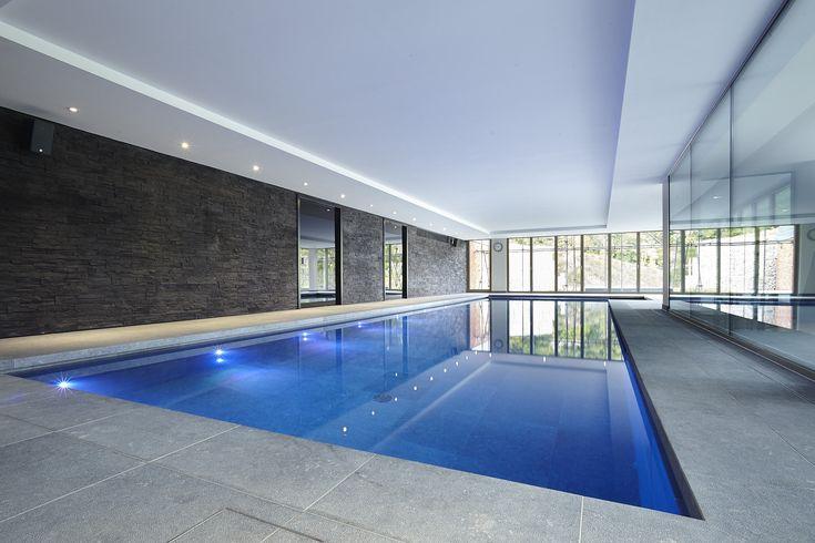 Luxury indoor swimming pool with bespoke lighting