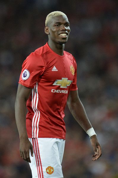 Manchester United's French midfielder Paul Pogba smiles during the English…