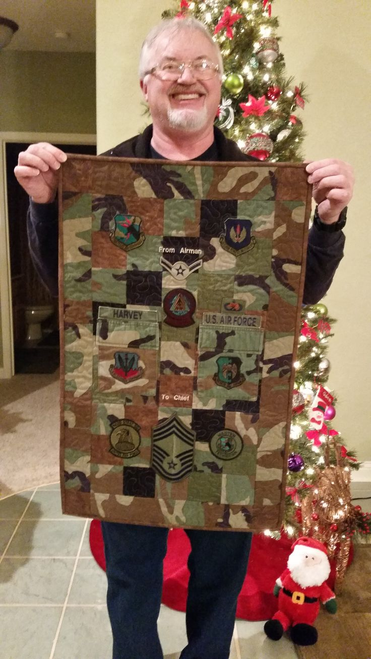 Military Career quilt.  Cut up an old uniform and saved patches and stripes, to make a memory.  Put all his stations on the back.