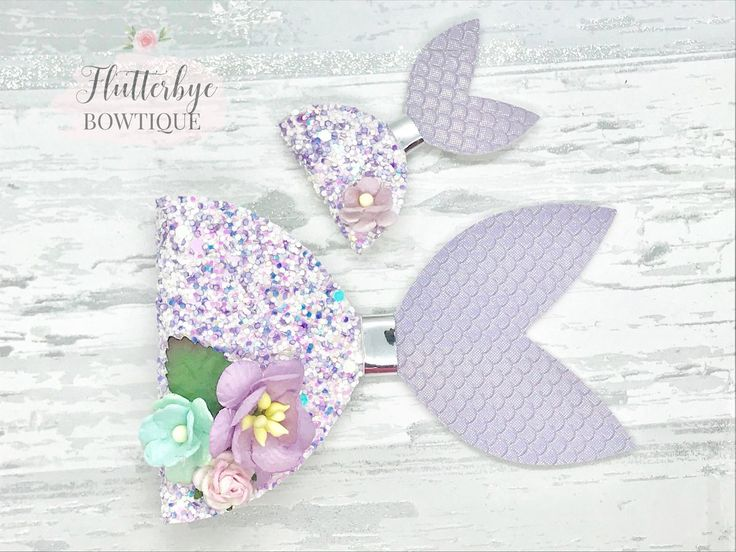 This beautifully sparkly mermaid hair bow is perfect for your little water baby. They are made using a gorgeous lilac mix chunky glitter fabric and...