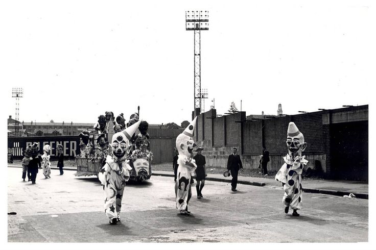 """Image 21806143 - Clowns parade ahead of a Luna Park float - part of the """"Australia's March to Nationhood"""" parade on January 26th, 1938. This image was taken in Driver Avenue, Moore Park. [RAHS Australia Day 1938 - Sesquicentenary Celebrations Collection]"""
