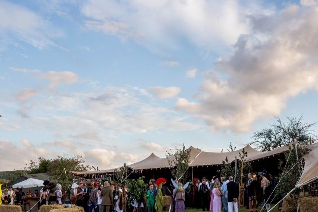 Festival wedding by freestretch.co.uk Stretchtent with festoonlights. Beautiful sky. Bonfire...