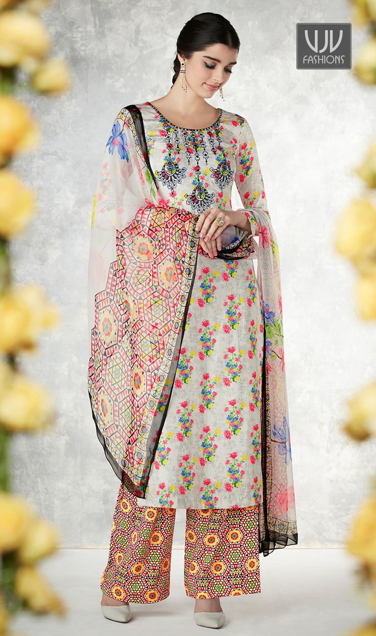 Riveting Multi Color Cotton Palazzo Style Suit  Add grace and charm on your appearance in this gorgeous Multi Color Cotton Palazzo Style suit. The ethnic embroidered and print work within the dress adds a sign of splendor statement with your look