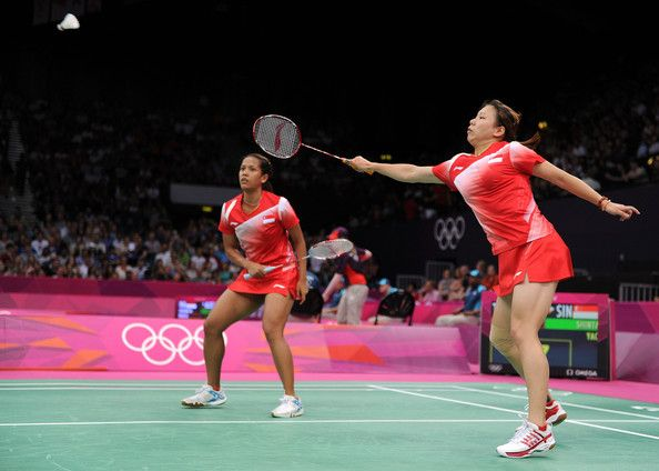 Lei Yao (R) and Shinta Mulia Sari (L) of Singapore return a shot against Wen Hsing Cheng and Yu Chin Chien of Chinese Taipei during their Women's Doubles Badminton on Day 1 of the London 2012 Olympic Games at Wembley Arena on July 28, 2012 in London, England.