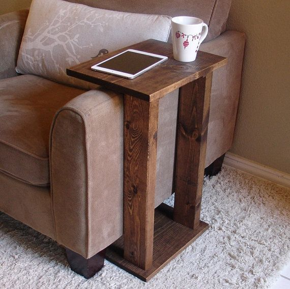 Handcrafted tray table stand. The perfect addition to a sofa chair in any home, apartment, or man cave.  It has been sanded down, then stained and sealed with a dark walnut finish. The stand is free standing and can be used anywhere around the house.  Non-marking, non-skid rubber pads are installed on the bottom of base of the stand. This piece does not include the accessory items as shown in the pictures.  The color of the stained wood captured in the photos might vary slightly…