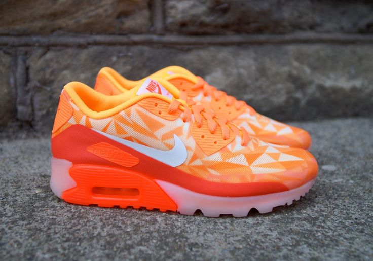 Far from being cold, the latest take on the Nike Air Max 90 Ice has arrived  with atomic mango scorching its entire body. From the top of its tongue to  the ...