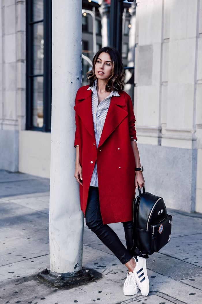 red coat with sporty chic outfit