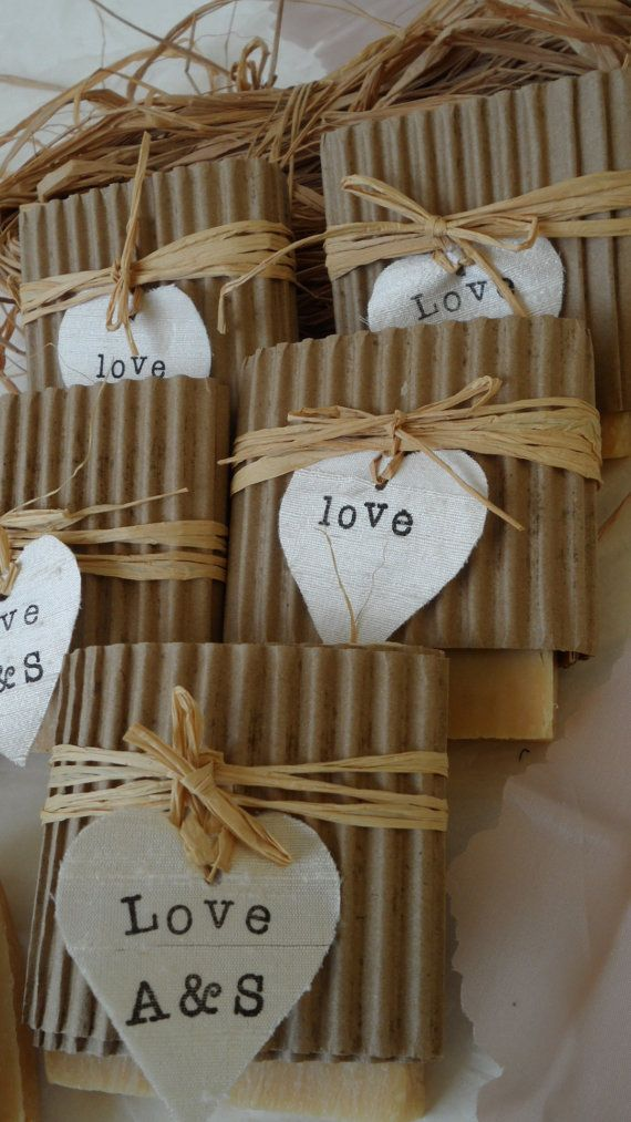 Rustic wedding favors. -i know we are thinking bookmarks, but I LOVE the wrapping and decor on these!