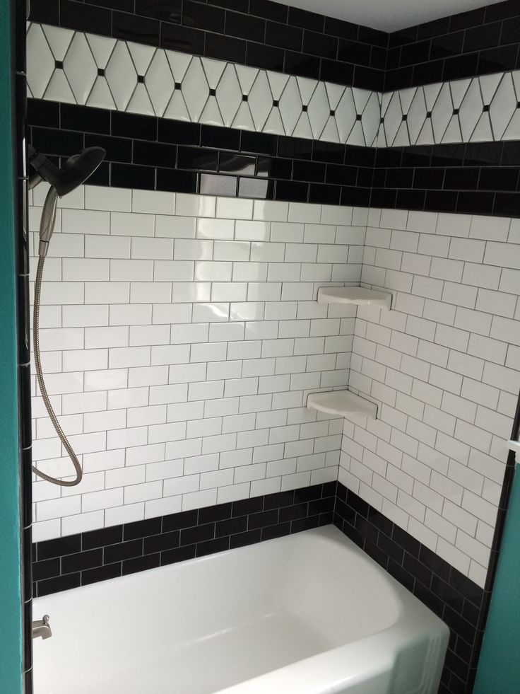 Black and white subway tile, black bullnose trim, and ...