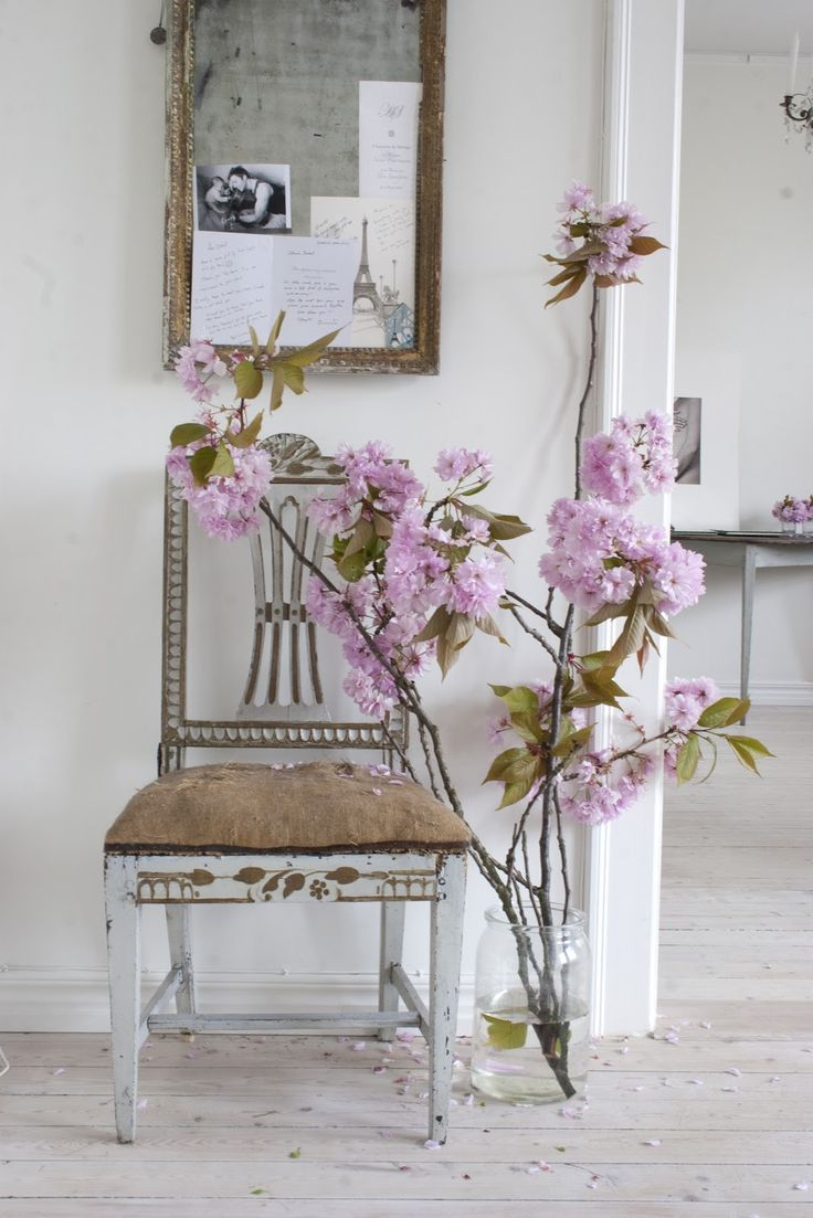 Such a simple but stunning vignette. Chippy chair and flowers.