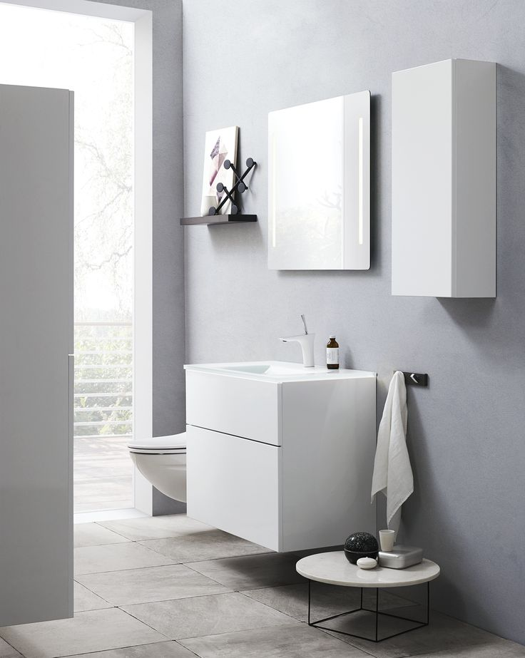Elegant vanity unit with push open in a 64 cm high version. The high drawer at the bottom provides generous storage possibilities.