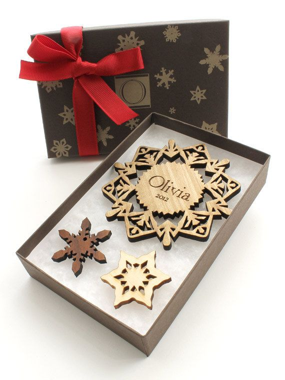 These custom tailored ornaments come ready to give with a 3 1/2 snowflake ornament laser engraved with a name of your choice, the year 2014 (or