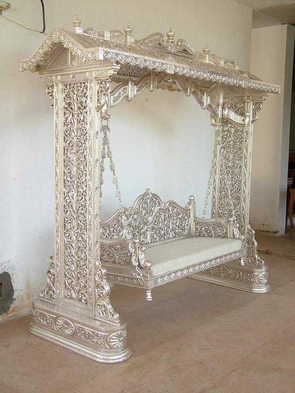 Classic Silvocrafts is presenting a finest collection of Silver Furniture and one of it is this silver swing. This is a royal swing, completely handcarved, certified teak wood. Imagine this in the backyard!