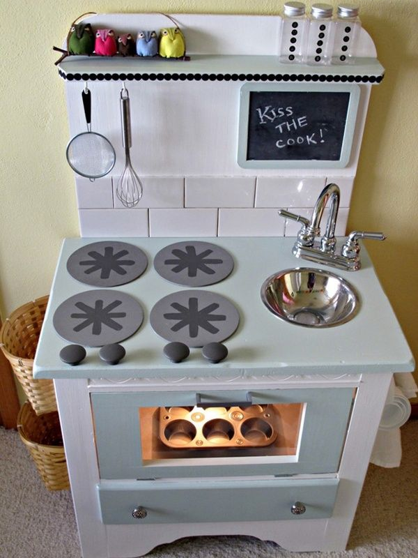 """Nightstand into a kitchen, like the lighted """"oven"""". So much more creative and cute than those plastic behemoths."""