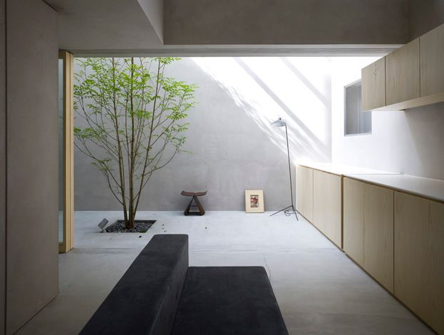 indoor outdoor kitchen. continuous rendered concrete