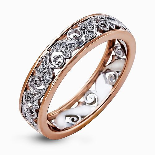 The lovely paisley design of this vintage inspired white and rose gold band is highlighted by .11 ctw of round cut white diamonds.
