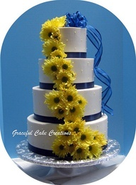 White, Navy Blue and Yellow Wedding Cake. I am really liking the sunflowers