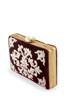 Velvet clutch embellished with thread embroidery with metal frame from #Benzer #Benzerworld #clutch #potli #ethnicbags
