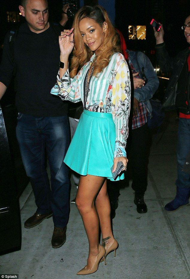 Rihanna in a floral and stripe print blouse, turquoise skater skirt and nude pumps