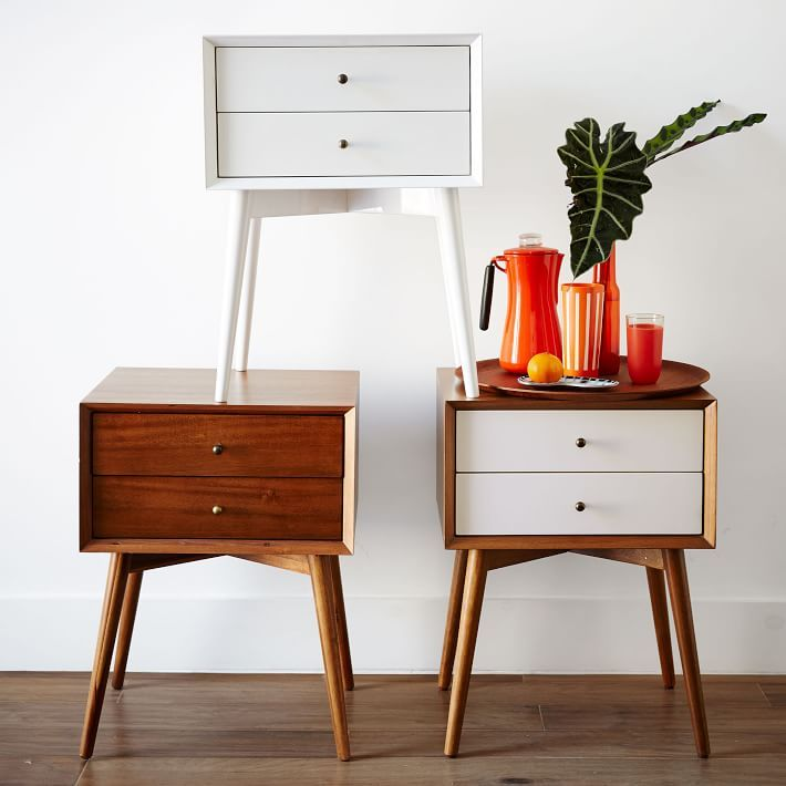 Simple, sophisticated storage. Inspired by mid-century design, the Mid-Century Nightstand borrows its slim legs, angled face and understated retro details from iconic '50s and '60s furniture silhouettes. Antique-bronze-finish knobs on the drawers provide an unexpectedly luxe twist to the clean-lined silhouette.