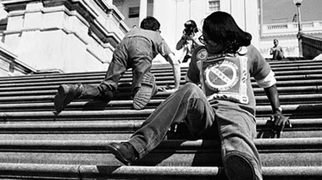 Protesters crawling up the steps to the Capitol on March 12, 1990 demanding passage of the Americans with Disabilities Act (ADA).