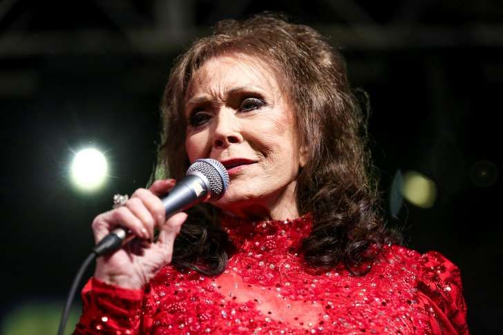 FILE - In this March 17, 2016 file photo, Loretta Lynn performs at the BBC Music Showcase at Stubb's during South By Southwest in Austin, Texas. The eight-time CMA winner was the very first female vocalist of the year and she's planning be at the 50th annual CMA Awards next Wednesday as many of her career milestones have played out on that stage. (Photo by Rich Fury/Invision/AP, File):