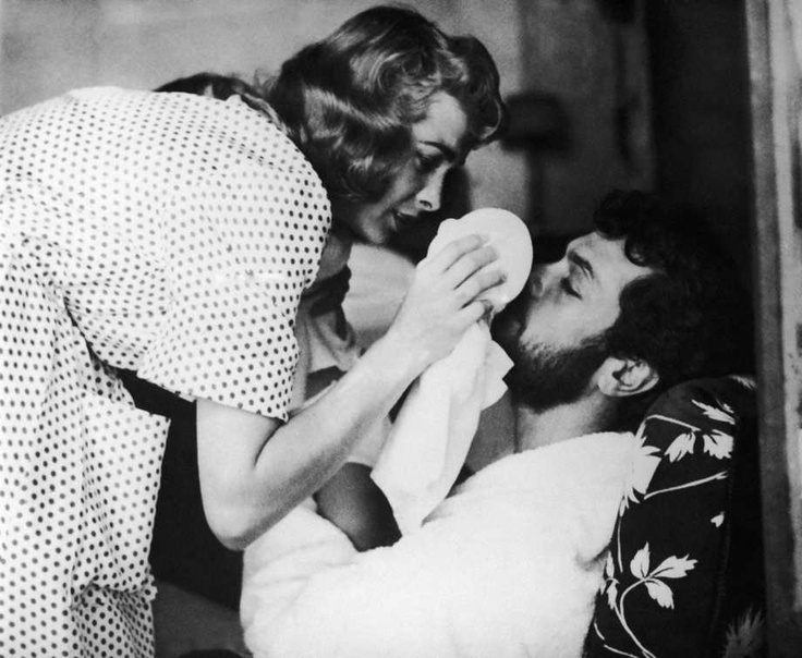 Janet Leigh treats her husband Tony Curtiss left eye during shooting of The Vikings on July 12, 1957 near Dinard in Brittany, France.