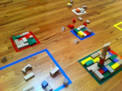 Tape squares onto the floor and use blocks to fill up the inside of the square.  A great spacial exercise--They can fill it however they want but filling it evenly is the trick.