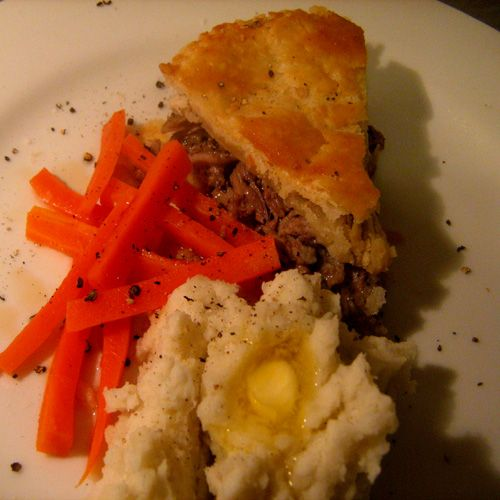 Acadian Meat Pie served with maple carrots  and mash