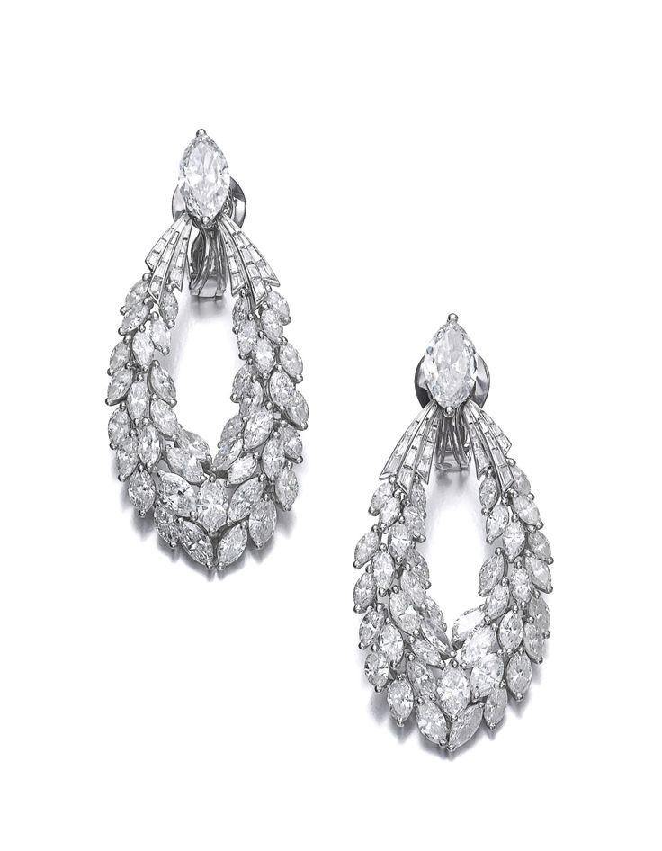 Pair of diamond ear clips, Kern. Each set with a marquise-shaped diamond suspending a swag of marquise-shaped and baguette diamonds, each signed Kern, numbered.
