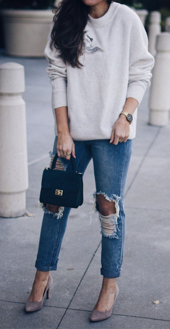 #winter #outfits  women's gray sweater and ripped blue denim jeans