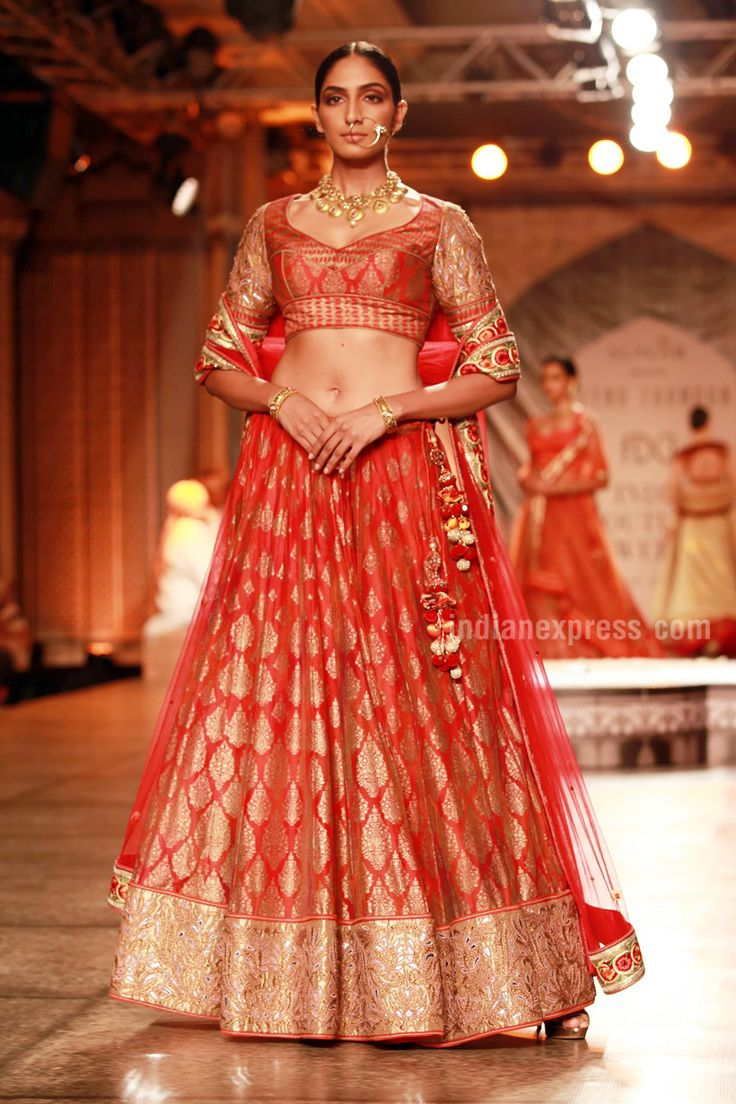 "Reynu Taandon's Collection at at #IndiaCoutureWeek 2016: ""The collection was all about redefining the traditional bride featuring the whole zari and gota tradition of the state in hues of red and gold.""via www.TopUPYourTrip.com"