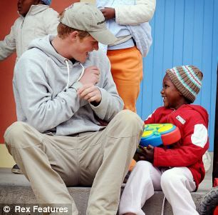 Prince Harry during his Caribbean tour - his first on behalf of the Queen in her Diamond Jubilee year.