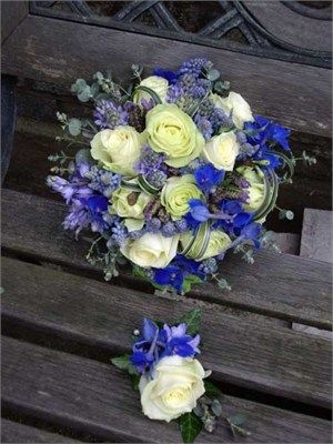 A mix of bluebells, muscari, white roses,blue delphinium, lavender and loops of varigated lily grass