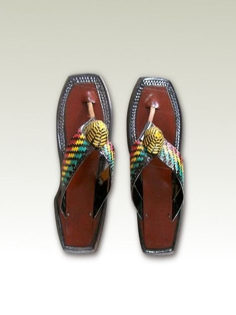 Ahenemaa Men Sandals    Originally meant for chiefs, this beautifully designed native African leather sandals are comfortable to wear. The Ghana flag colors make it a great match for traditional African wear.