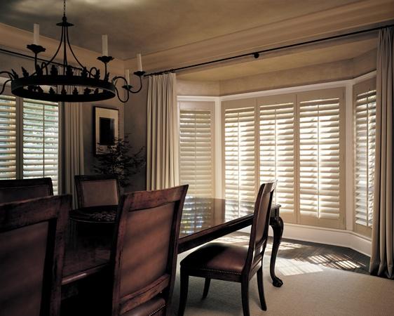 Timeless beauty, enduring craftsmanship, an exquisite dining room––Heritance® hardwood shutters ♦ Hunter Douglas window treatments