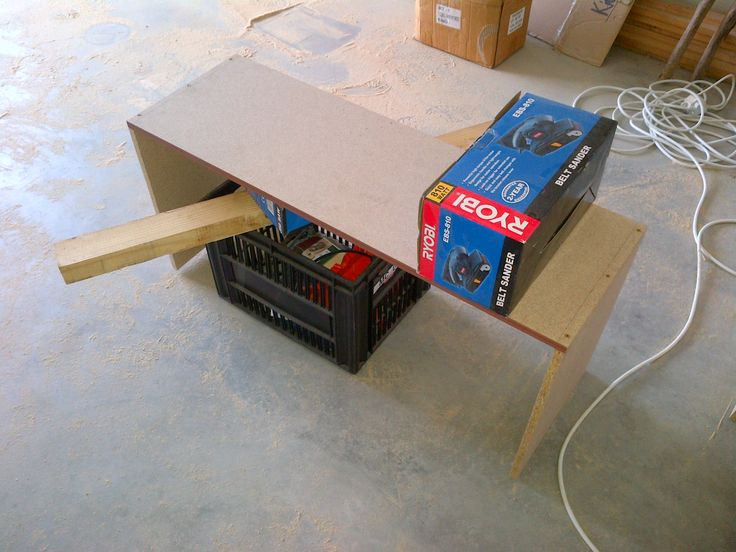 """2. Next up I assembled the box. It's a bit tricky if you don't have all the right tools, but with a couple of paint cans and boxes I managed a """"table"""" of sorts."""
