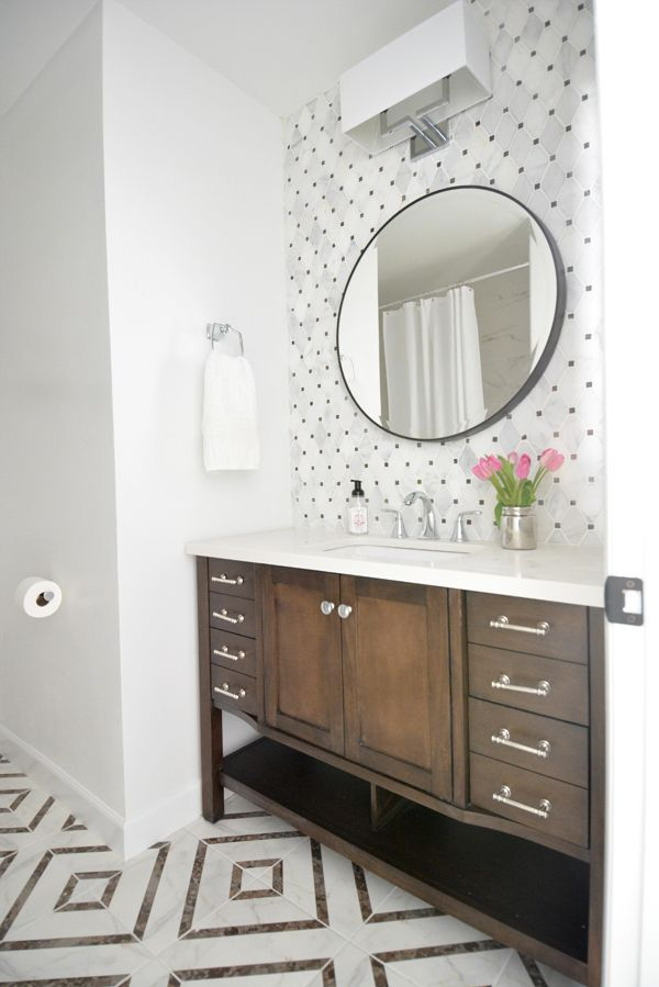 1980's Hall Bathroom Makeover -  allen + roth Kingscote espresso free standing vanity from Lowe's, got rid of orange-peel wall texture and painted Glidden White on White, diamond-shaped marble mosaic backsplash, bold geometric porcelain tile on floor to add pattern and interest,