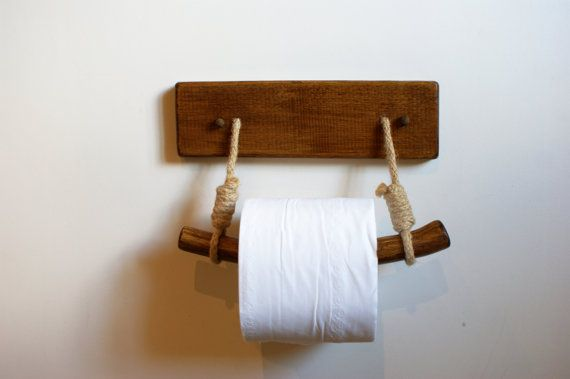 Here we offer a unique wall mounted toilet paper holder. Hand made from oak wood and natural jute twisted cord. Our unique design will bring